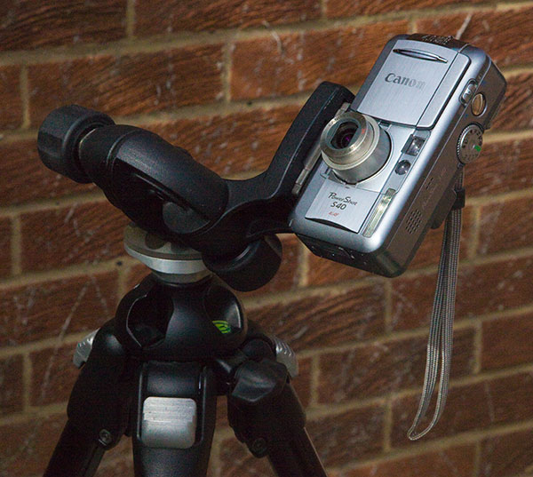 Photo of Canon S40 compact camera on tripod, aimed at sky